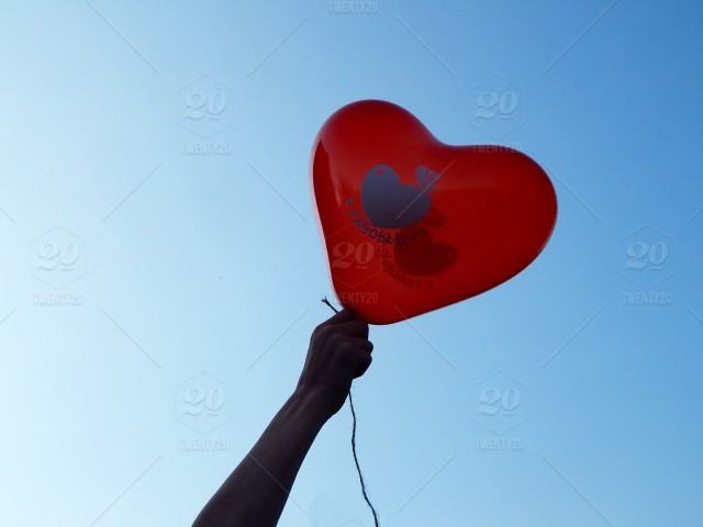 stock-photo-love-human-hand-heart-valentines-day-balloons-ballooning-hearts-lovely-reds-fd6ab61e-d1f0-4195-b472-cf86d8a6cede